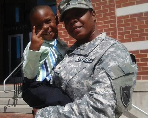 "Iraq and Afghanistan soldier Sgt. LuWanda Knuckles and her son, Zavian. Knuckles is the Kentucky Department of Veterans Affairs' women veterans coordinator. CWV Director Kayla M. Williams says, ""... 25 percent of vet center employees are women veterans who have served in a war zone."""