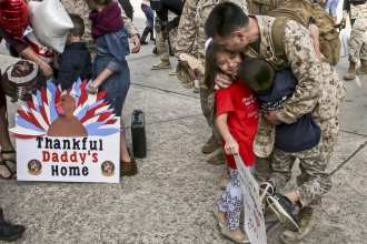 A Marine greets his family at Marine Corps Air Station Beaufort, S.C., Nov. 21, after returning from a seven-month deployment. (Marine Corps photo by Lance Cpl. Terry Haynes III)