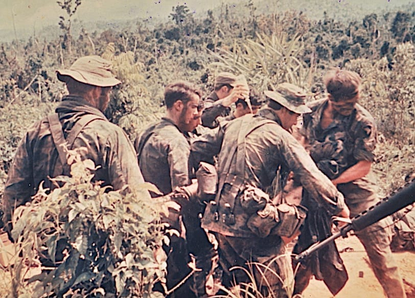 In Vietnam, a Ranger LRRP from L Company evacuates a casualty during Operation Bushmaster, August 1971.