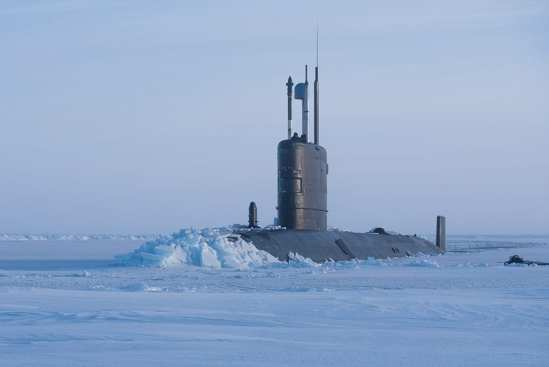 HMS Trenchant Surfaces Through Arctic Ice | Video