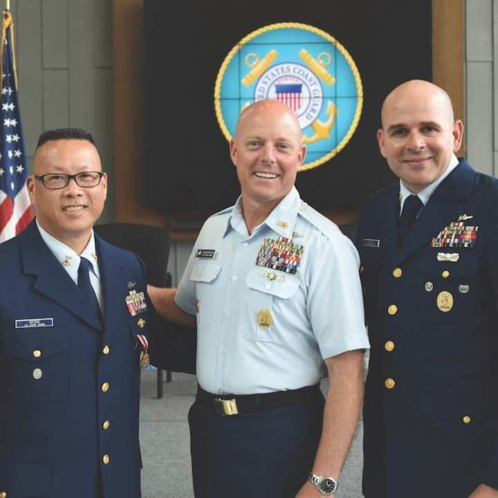 Master Chief Petty Officer of the Coast Guard Jason Vanderhaden congratulates Master Chief Jason Wong on his new assignment to U.S. Coast Guard Pacific Northwest.