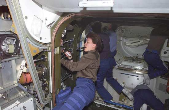 astronaut working on Quest Airlock ISS web