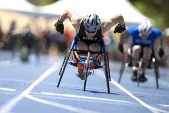 Team Army Sgt. John Weasner finishes a wheelchair race during the 2018 Warrior Games at the Air Force Academy in Colorado Springs, Colo. June 2, 2018. (DoD photo by EJ Hersom)