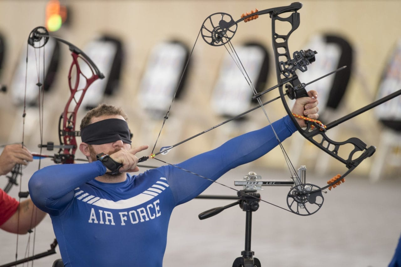 Air Force veteran Senior Airman Brett Campfield competes in the visually impaired classification in archery during the 2018 DoD Warrior Games at the U.S. Air Force Academy in Colorado Springs on June 7, 2018. The Warrior Games are an annual event, established in 2010, to introduce wounded, ill and injured service members to adaptive sports as a way to enhance their recovery and rehabilitation. (DoD Photo by Roger L. Wollenberg)