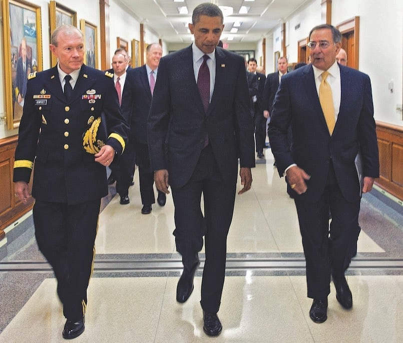 President of the United States Barack Obama walks with Secretary of Defense Leon Panetta and Gen. Martin Dempsey, chairman of the Joint Chiefs of Staff, to a briefing at the Pentagon on Jan. 5, 2012. Obama and Panetta delivered remarks on the Defense Strategic Guidance for the Defense Department going forward. They were joined by Deputy Defense Secretary Ashton Carter and the members of the Joint Chiefs and service secretaries. DOD Photo by Erin A. Kirk-Cuomo
