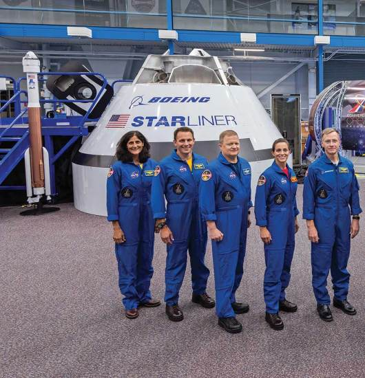 Boeing Starliner mockup and crew ISS web
