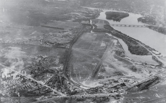 The location selected for the Pentagon, on the site of the old Washington-Hoover Airport in Arlington, Virginia. The runways of the airport can still be seen in this photograph, as well as the airfield's hangars, one of which soon was filled with architects and draftsmen producing thousands of pages of blueprints for the building. National Archives photo