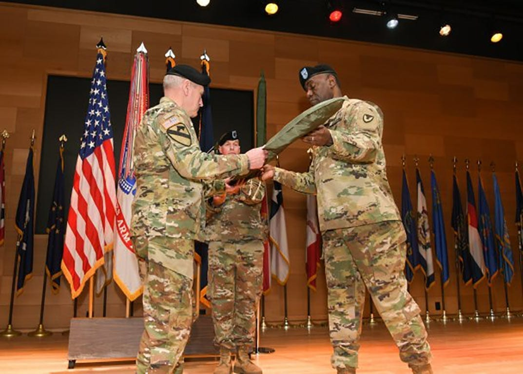Gen. John M. Murray, commanding general Army Futures Command, and Maj. Gen. Cedric T. Wins, commanding general Combat Capabilities Development Command, uncase the official flag, signifying the transition of the U.S. Army Research, Development and Engineering Command from Army Materiel Command to AFC. Photo Credit: Conrad Johnson