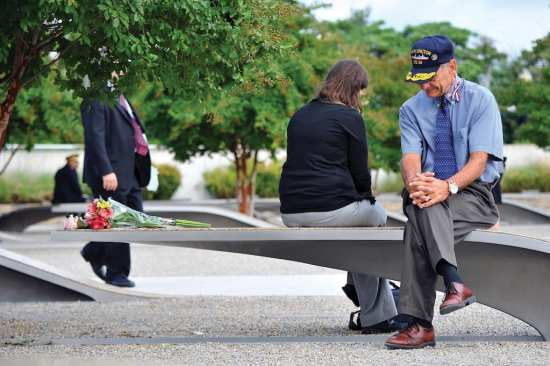 Herb Wolk (right) and his daughter, Devora Kirschner, reflect while sitting on a bench that serves as a memorial for Navy Lt. Darin Pontell before the 9/11 memorial ceremony at the Pentagon, Sept. 11, 2014. Kirschner was married to Pontell when he was killed during the attack on the Pentagon Sept. 11, 2001. DOD photo by U.S. Air Force Staff Sgt. Jette Carr