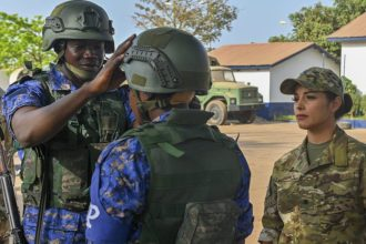 U.S. Coast Guard Maritime Enforcement Specialist 3rd Class Raven Perry inspects tactical equipment of members of the Gambian navy before conducting a simulated drug smuggling and human trafficking scenario during Exercise Obangame Express 2019 in Banjul, Gambia, March 16, 2019. . Navy photo by Mass Communication Specialist 2nd Class Tamara Vaughn/Released