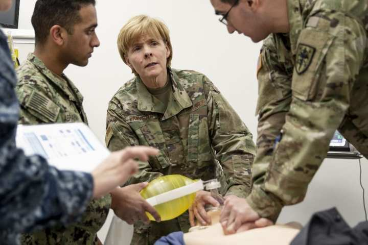 Brigadier General Sharon Bannister, MD, participates in the first Red Cross advanced resuscitation courses to medical professionals at the Uniformed Services University.