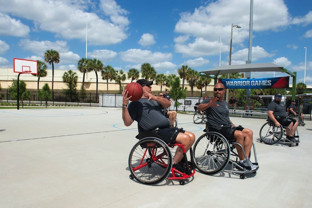 Care Coalition athletes play wheelchair basketball during the U.S. Special Operations Command Warrior Care Program (Care Coalition) All Sports Camp in Tampa, Fla., March 14, 2019. The camp was designed to develop the USSOCOM team roster for the 2019 Warrior Games. The games introduce wounded, ill and injured service members and veterans to Paralympic-style sports and showcase their resiliency