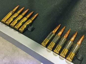 Belted .338 Norma Magnum cartridges for the Lightweight Medium Machinegun (LWMMG). On the left are conventional cartridges, and on the right, polymer-cased cartridges.
