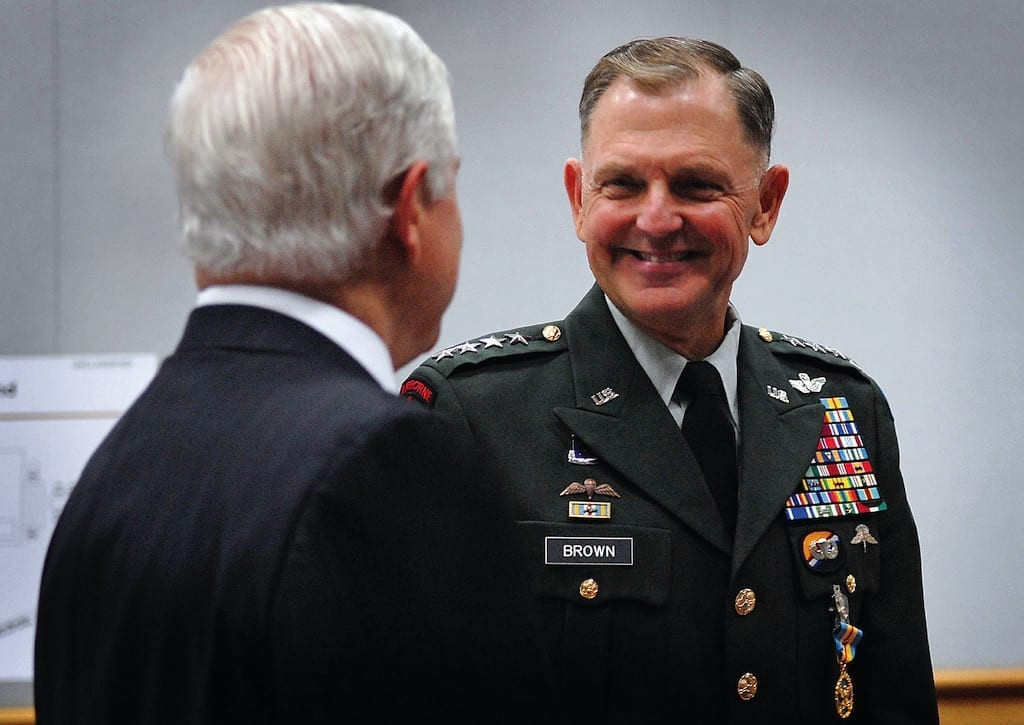 U.S. Army Gen. Doug Brown speaks with Secretary of Defense Robert M. Gates prior to the U.S. Special Operations Command change of command ceremony at the Tampa Convention Center in Tampa, Fla., July 9, 2007. Brown, who has commanded USSOCOM since September 2003, is retiring from active duty after 40 years of service to the nation