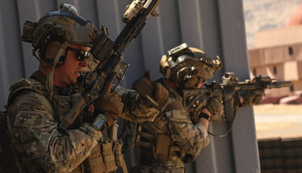 A U.S. Special Forces soldier, assigned to 10th Special Forces Group (Airborne), changes magazines after spotting enemy movement during a combat training exercise at the Nevada Test and Training Range near Nellis AFB, Nevada, Aug. 28, 2018.
