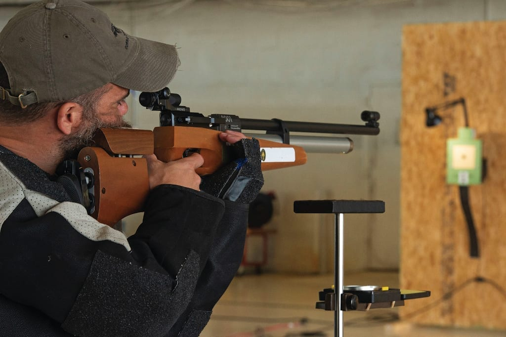 Retired Navy Lt. Isaiah Staley, a Care Coalition athlete, fires an air rifle during the U.S. Special Operations Command Warrior Care Program (Care Coalition) All Sports Camp in Tampa, Florida, March 14, 2019. The camp was designed to develop the USSOCOM team roster for the 2019 Warrior Games
