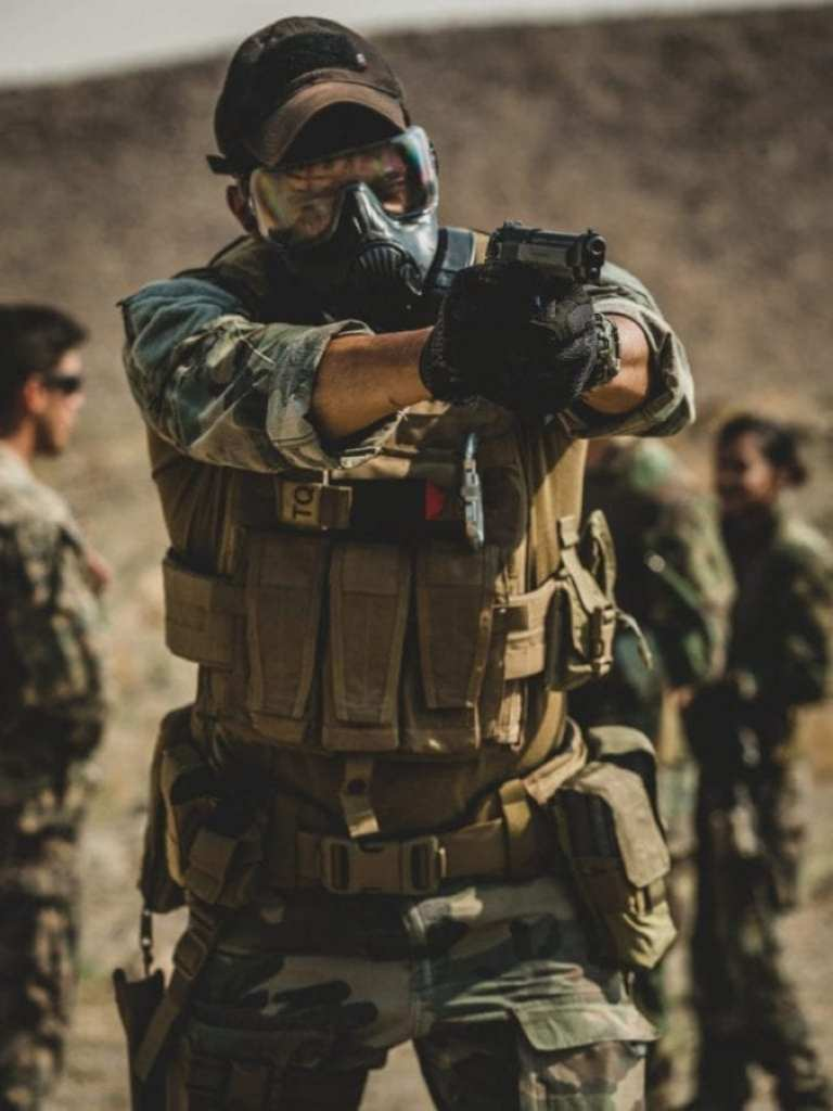 During Training Readiness Exercise II, a Marine with 1st Marine Raider Support Battalion aims his pistol down range during an exercise, at a training area in Hawthorne, NV, Aug. 1, 2018. The purpose of this training was to create a realistic simulation of multiple operating environments while challenging the team with a hybrid threat.