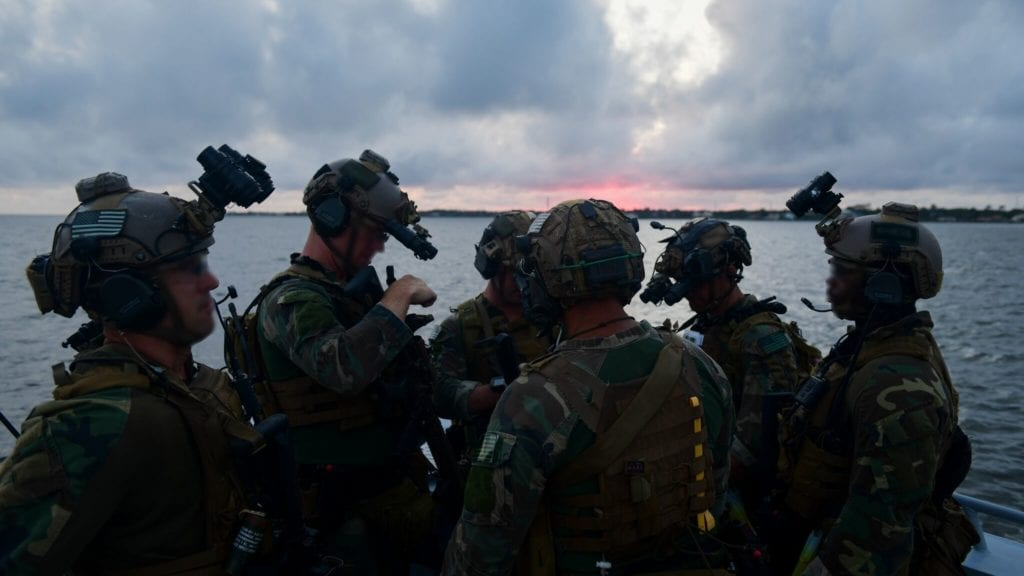 U.S. Marine Corps Raiders with the 3d Marine Raider Battalion ride on a 1st Special Operations Support Squadron watercraft at Eglin Range, Fla., May 30, 2018. The 1st Special Operations Support Squadron Operations Support Joint Office coordinates two-week training programs for U.S. Army, Navy and Marine special operations forces that provides live-fire ranges and familiarizes them with Air Force Special Operations Command assets to ensure global readiness