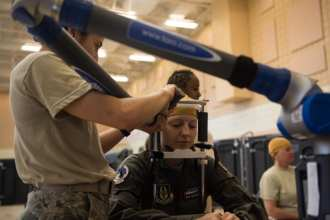An airman is getting her head measured as a model of female aviators to use when designing female flight equipment prototypes. U.S. Air Force photo by Airman 1st Class Marcus M. Bullock