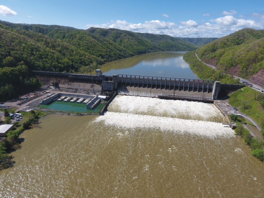 An aerial view of Bluestone Dam as it releases water held back during a storm to reduce levels downriver.