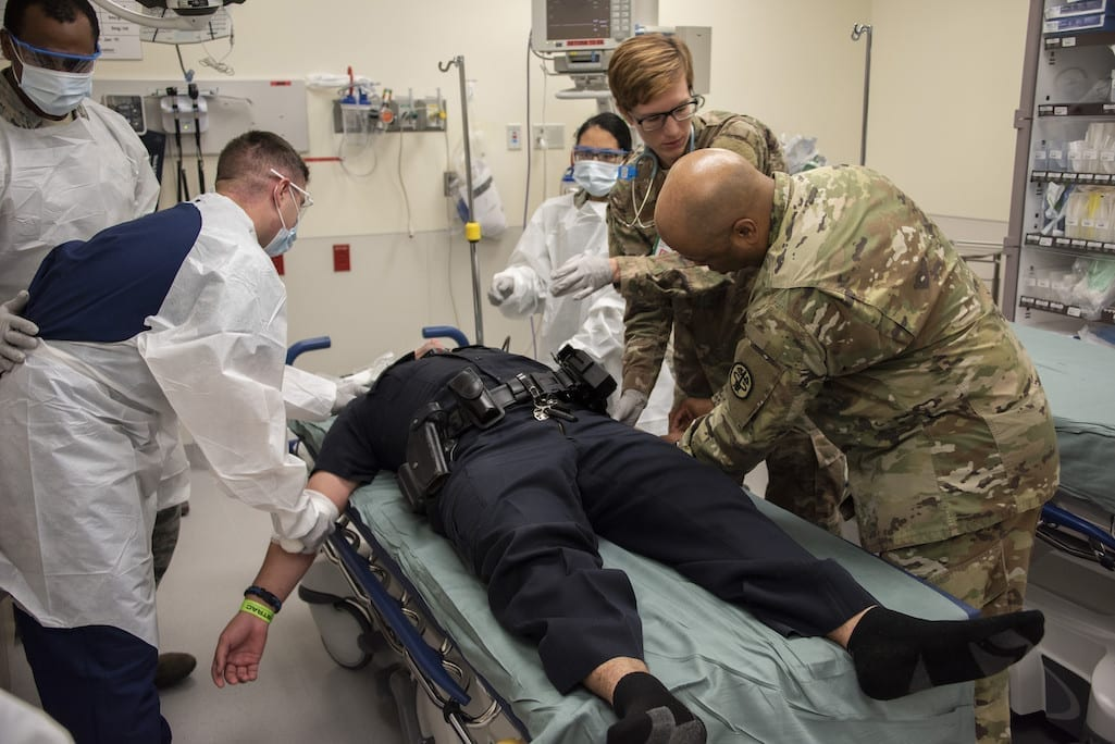 Members of Brooke Army Medical Center's medical staff simulate emergency care during the 2018 San Antonio Mass Casualty Exercise and Evaluation at Brooke Army Medical Center, Fort Sam Houston, Texas, Oct. 11, 2018. (Photo by Jason W. Edwards)