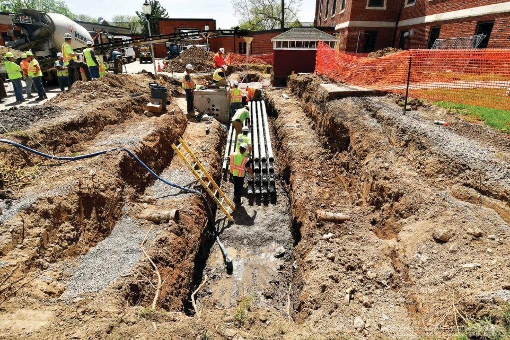 Personnel from USACE contractor Pike-P.J. Dick prepare to encase electrical conduits in concrete to deliver power to the future outpatient clinic and temporary kitchen, May 18, 2018.