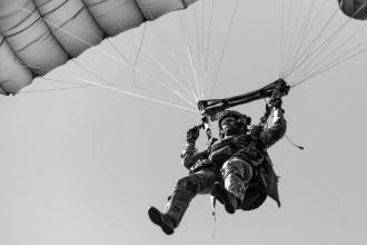 A U.S. Army Green Beret assigned to 19th Special Forces Group (Airborne) lands during a Military Freefall operation June 19, 2019 near Cincu, Romania as part of Trojan Footprint 19. Trojan Footprint is an annual U.S. Special Operations Command Europe-led exercise that incorporates Allied and partner special operations forces, this year's exercise brought together 1400 SOF from ten nations for training over land, sea and air across Bulgaria, Hungary, Romania and the Black Sea. (U.S. Army photo by Staff Sgt. Alex Manne)