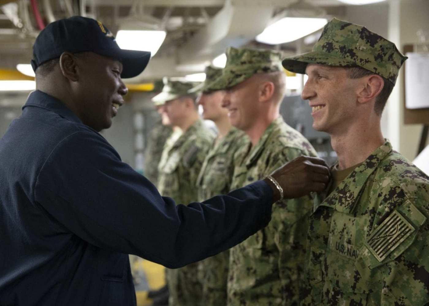 Command Master Chief De'Andre Beaufort performs a uniform inspection on the engineering department's repair division Sailors as part of Division in the Spotlight aboard the aircraft carrier USS Gerald R. Ford (CVN 78). Gerald R. Ford is currently undergoing its post-shakedown availability at Huntington Ingalls Industries-Newport News Shipbuilding. (U.S. Navy photo by Mass Communication Specialist Seaman Apprentice Zack Guth/Released)