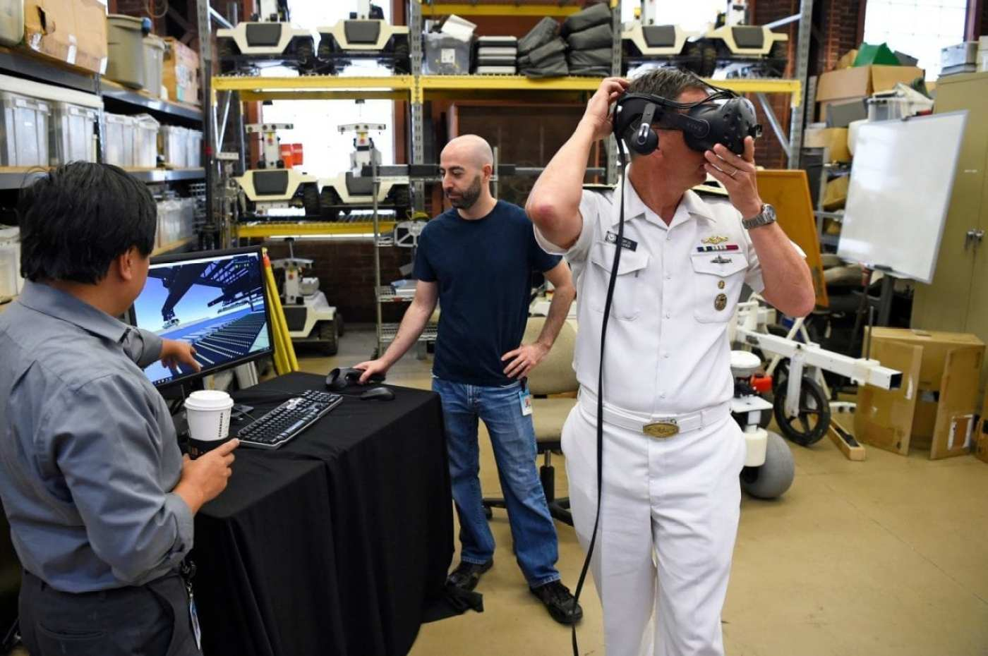 Rear Adm. David Hahn tours the National Robotics Engineering Center (NREC) during a visit to Carnegie Mellon University (CMU) in Pittsburgh, Pennsylvania. Hahn was at CMU to attend the Artificial Intelligence (AI) & Autonomy for Humanitarian Assistance and Disaster Relief (HADR) workshop, co-hosted by the Office of Naval Research and CMU.