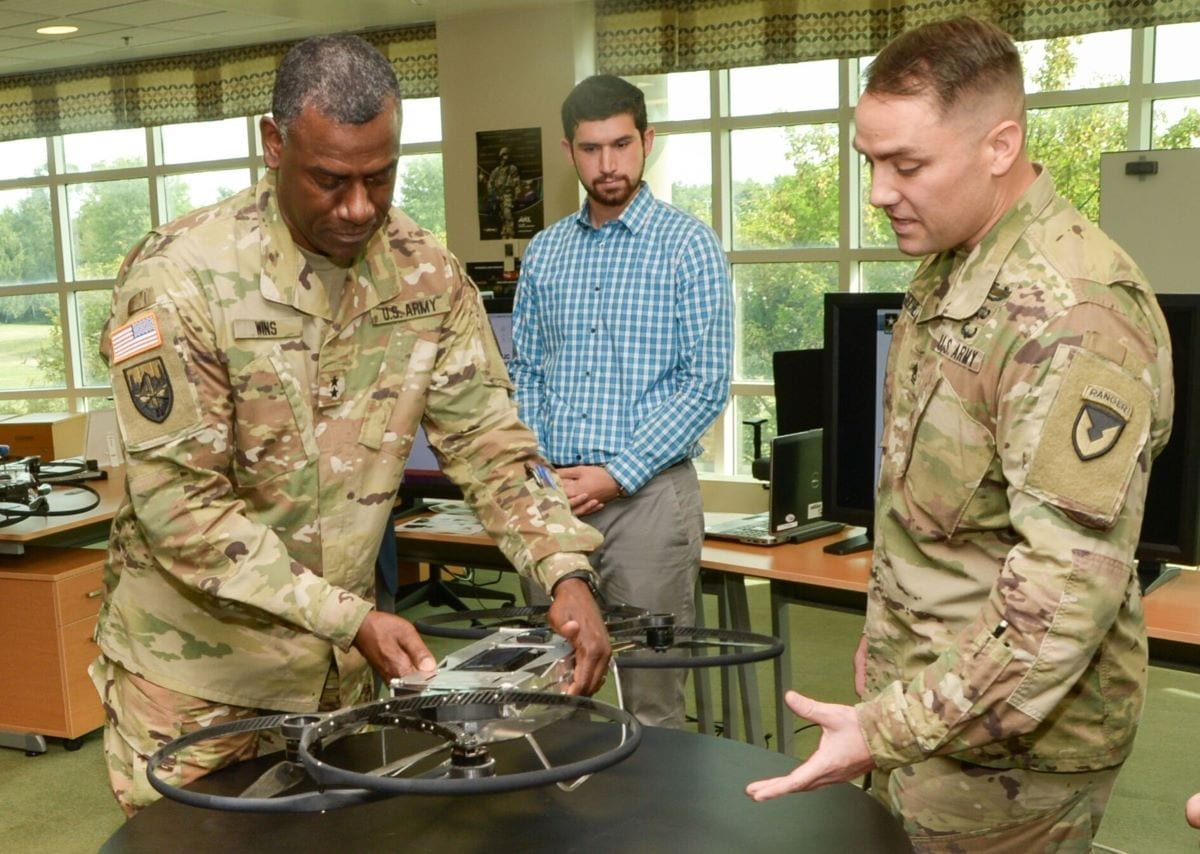 "Maj. Gen. Cedric T. Wins (left), commanding general of the U.S. Army Combat Capabilities Development Command, learns about a prototype version of the Joint Tactical Aerial Resupply Vehicle, or JTARV, from Sgt. 1st Class Daniel Guenther (right), an enlisted advisor at the Army Research Laboratory Weapons and Materials Research Directorate, during a visit at Aberdeen Proving Ground, Maryland. Also known as the ""hoverbike,"" the JTARV may one day enable soldiers on the battlefield to order resupply and then receive those supplies rapidly from an autonomous unmanned aerial vehicle."