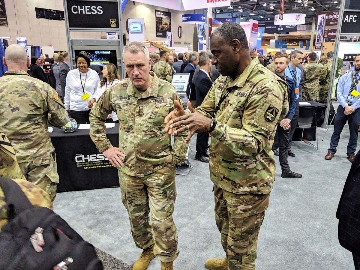 """John """"Mike"""" Murray (left), commanding general of Army Futures Command, receives a brief by Maj. Gen. Cedric Wins (right), commanding general of Combat Capabilities Development Command, highlighting CCDC's innovative technological solutions on display at AUSA Global Force Symposium 2019 in Huntsville, Alabama."""