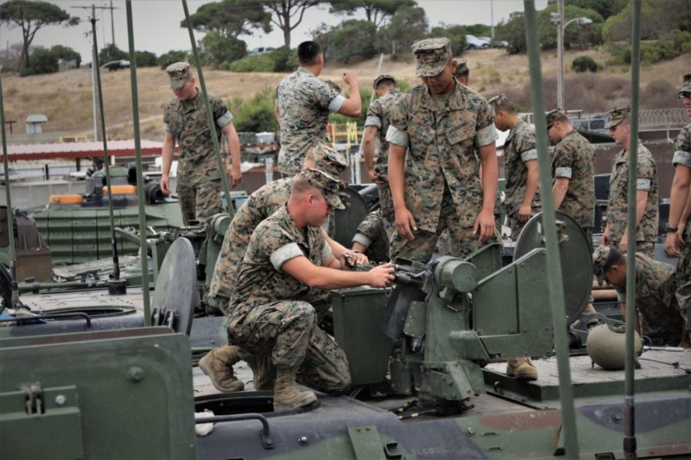 Marines from Delta Company, 3rd Assault Amphibian Battalion, examine the Common Remotely Operated Weapons System on the Amphibious Combat Vehicle for the first time Sept. 11, 2019, at the Amphibious Vehicle Test Branch aboard Camp Pendleton, California. (U.S. Marine Corps photo by Ashley Calingo)