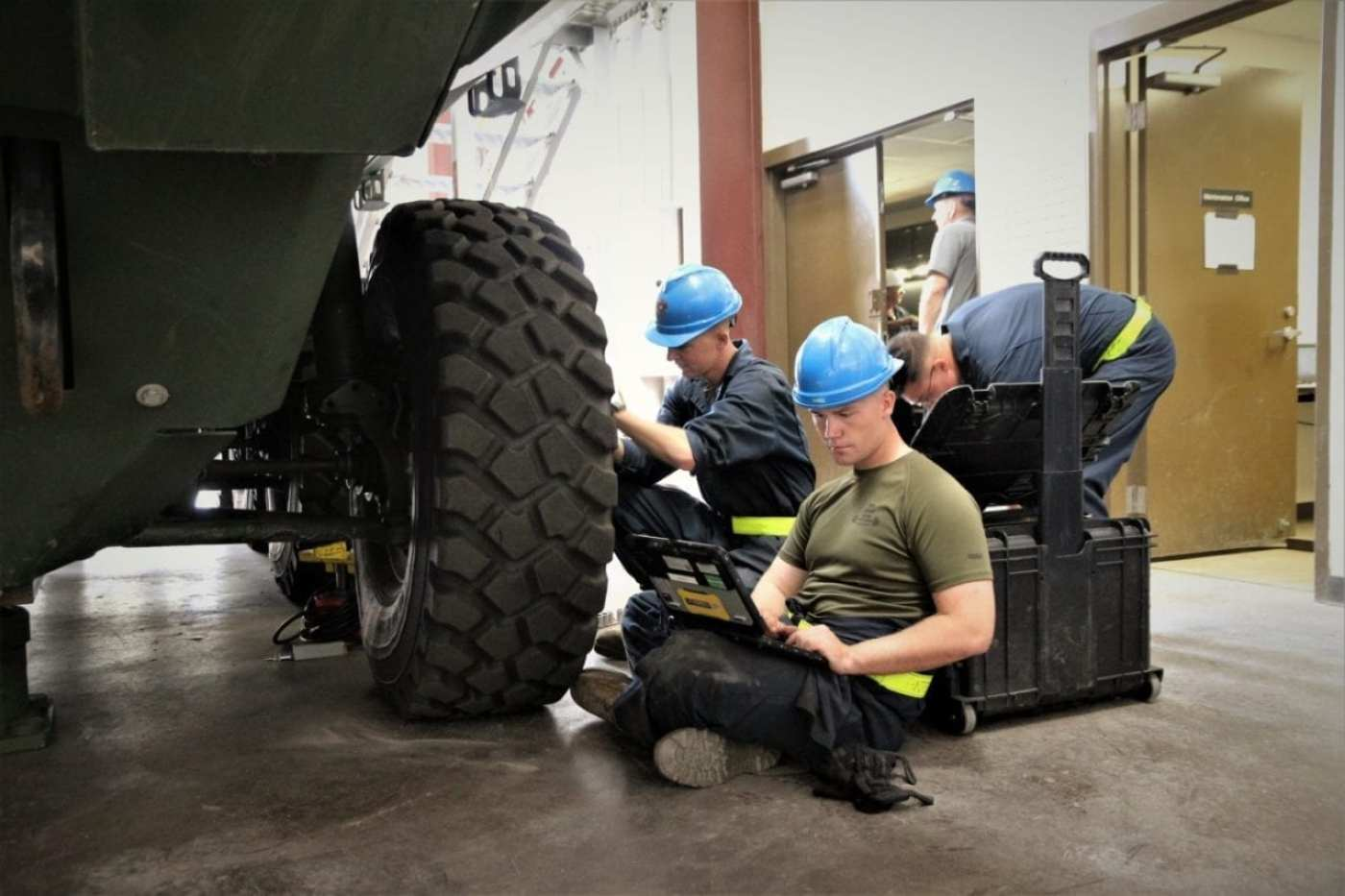 Cpl. Patrick Canterbury reads off instructions from the Interactive Electronic Technical Manual while Cpl. Austin Boyd performs a maintenance task on the Amphibious Combat Vehicle during the Logistics Demonstration aboard Camp Pendleton, California, on Sept. 11, 2019. Log Demo is designed to evaluate and correct, if needed, the maintenance and operational manuals for the ACV that will be eventually used by fleet Marines. (U.S. Marine Corps photo by Ashley Calingo)