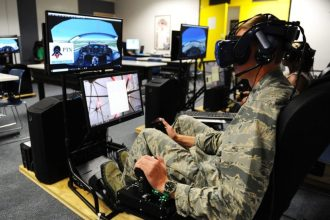 Cadet 1st Class Cade Cavanagh uses an immersive training device during a Pilot Training Next course this summer at the U.S. Air Force Academy airfield. (U.S. Air Force photo by Jennifer Spradlin)