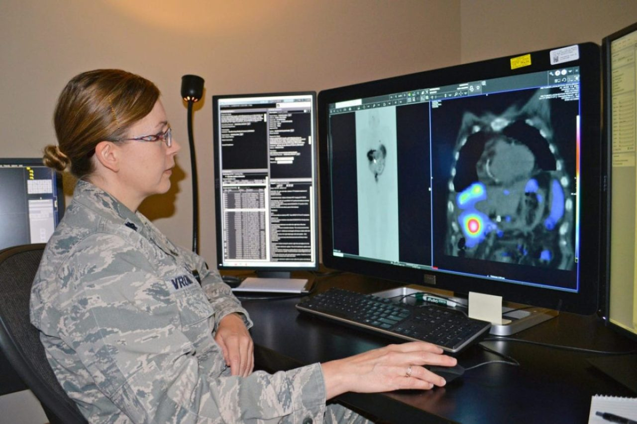 Air Force Lt. Col. Penny Vreman, Brooke Army Medical Center Nuclear Medical Department chief, looks at scans of a patient with neuroendocrine tumors June 26, 2019, to ascertain if a radiopharmaceutical that was administered is targeting the tumors.