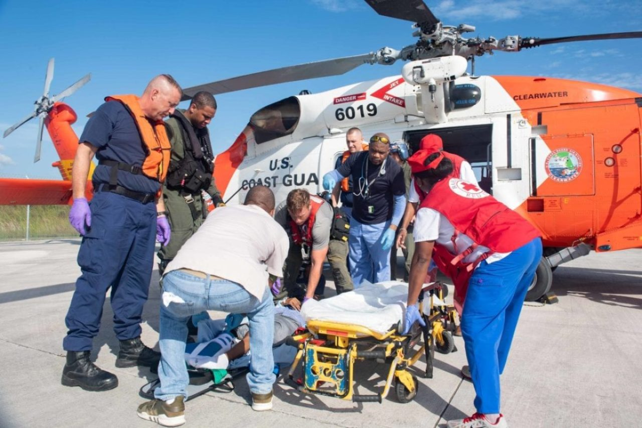 U.S. Navy Sailors and Coast Guard personnel transport a patient in response to Hurricane Dorian in the Bahamas, Sept. 6, 2019. In support of foreign disaster relief efforts in the Bahamas, the secretary of defense authorized U.S. Northern Command to provide transportation logistics for the movement of USAID and third-party humanitarian commodities and personnel throughout the region and to conduct assessments pf critical transportation nodes to facilitate the delivery of humanitarian assistance and maximize the flow of disaster relief into the area.