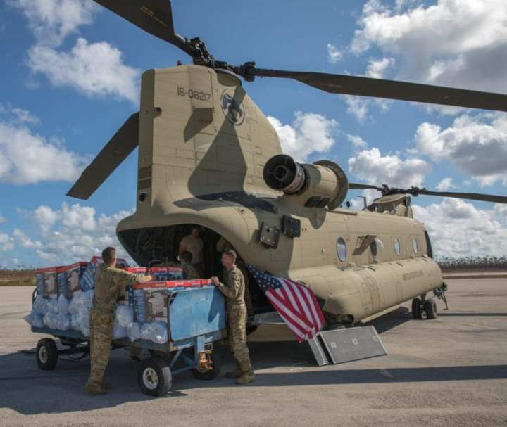 U.S. Army soldiers unloaded equipment from a U.S. Army CH-47 Chinook helicopter in the Bahamas, Sept. 9, 2019, in the wake of Hurricane Durian. In the days following the storm's landfall in the Bahamas, DOD ships and helicopters transported response personnel and tons of supplies between Nassau and storm-affected areas.