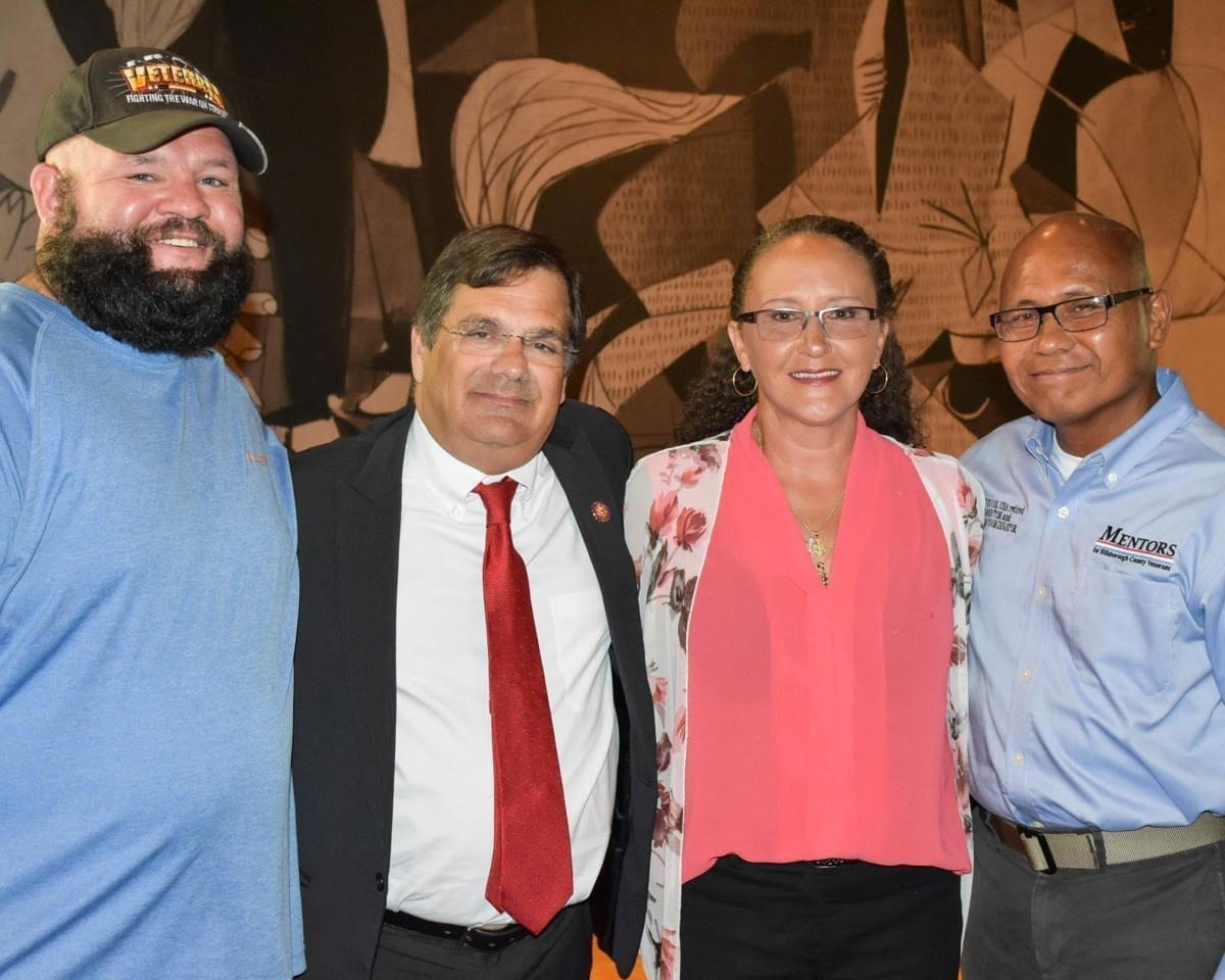 Rep. Gus M. Bilirakis pictured with three veterans in August 2019. In May 2019 Bilirakis introduced VET CARE Act, legislation that aims to expand existing dental care services to an increased number of veterans.
