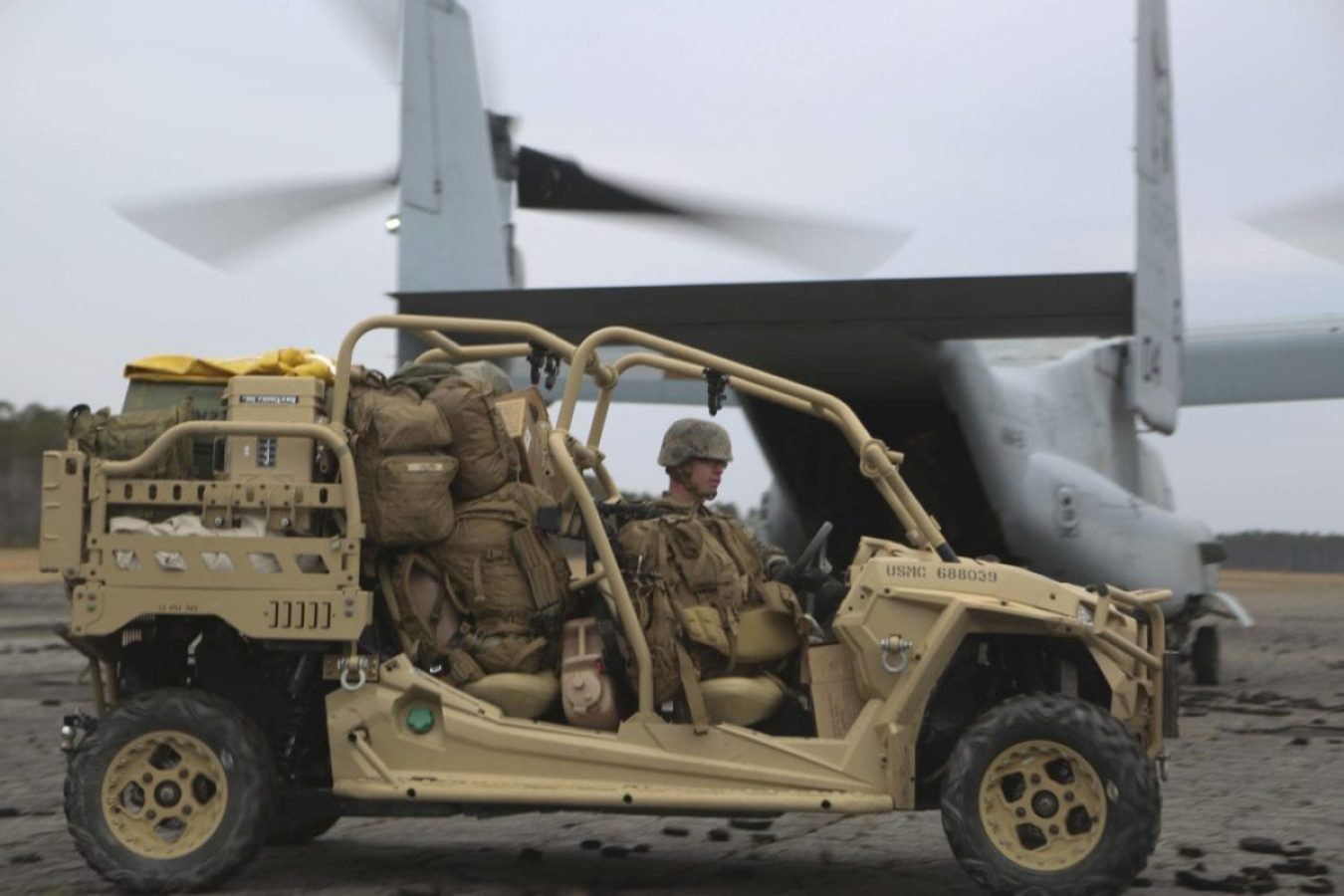 Marines unload a Utility Task Vehicle from an MV-22B Osprey on Camp Lejeune, North Carolina, Feb. 19, 2019. (U.S. Marine Corps photo by Lance Cpl. Camila Melendez)