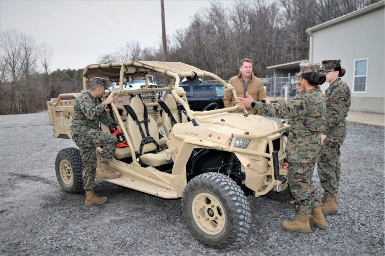 Jason Engstrom, center, a Utility Task Vehicle engineer with Program Executive Officer Land Systems, reviews several of the vehicles upgrades with Marines at the Transportation Demonstration Support Area aboard Marine Corps Base Quantico, Virginia, Dec. 4, 2019. (U.S. Marine Corps photo by Ashley Calingo)