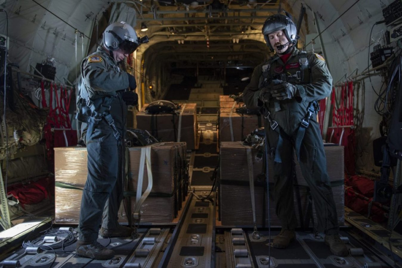 Master Sgt. Richard LaFrance 36th Airlift Squadron superintendent, left, and Tech. Sgt. Lou Splichal, 374th Operations Group executive officer, right, both out of Yokota Air Base, Japan, perform a final check of their safety equipment before executing the memorial drop for Senior Airman Jeremy Jutba-Hake during Operation Christmas Drop 2019, over Fananu, Federal States of Micronesia, Dec, 13, 2019. (U.S Air Force photo by Senior Airman Matthew Gilmore)