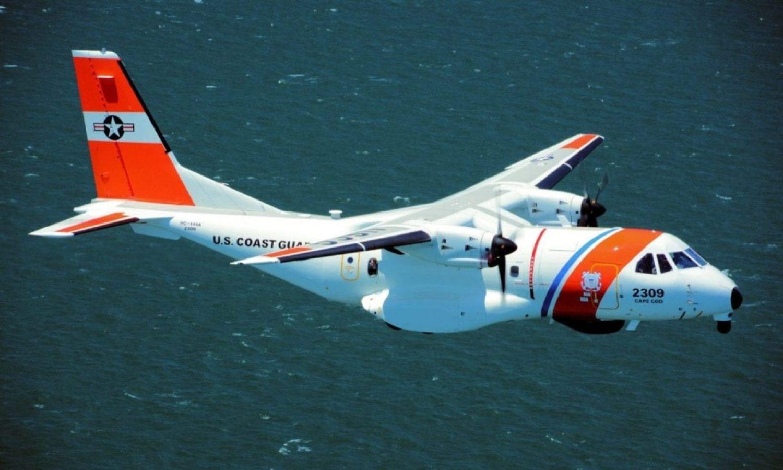 A Coast Guard Air Station Cape Cod HC-144 Ocean Sentry aircraft flies over Fort Adams, May 8, 2018, in Newport, Rhode Island
