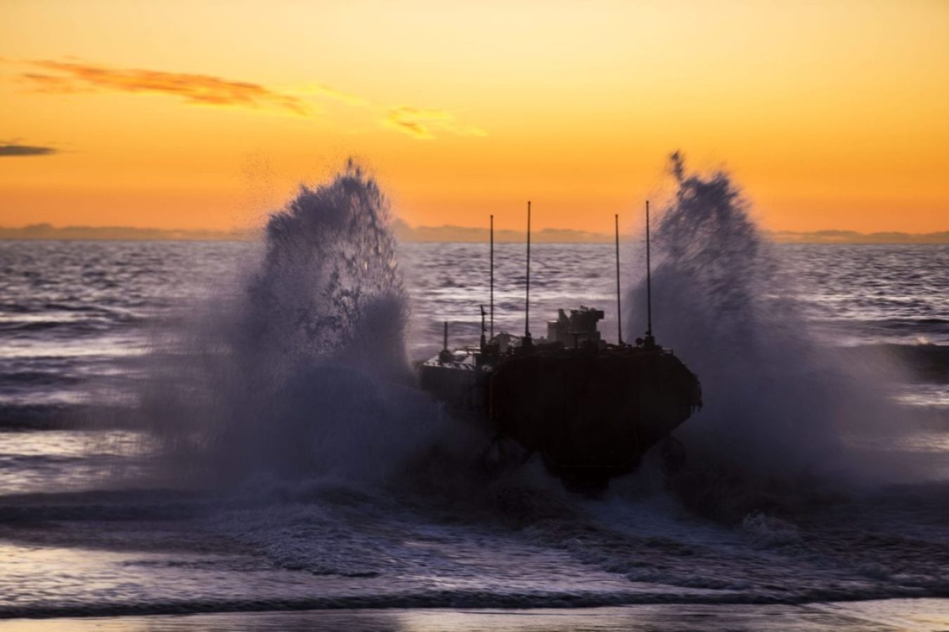 U.S. Marines with Amphibious Vehicle Test Branch, Marine Corps Tactical Systems Support Activity, drive a new Amphibious Combat Vehicle into the ocean during low-light surf transit testing at AVTB Beach on Marine Corps Base Camp Pendleton, California, Dec. 18.