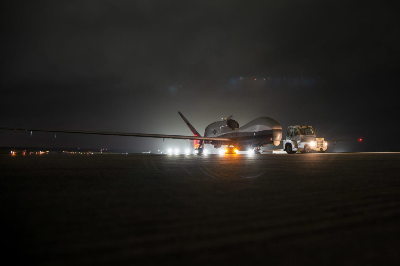 Triton unmanned aircraft system (UAS) idles on a runway at Andersen Air Force Base after arriving for a deployment as part of an early operational capability (EOC) test to further develop the concept of operations and fleet learning associated with operating a high-altitude, long-endurance system in the maritime domain. (U.S. Navy photo by Mass Communication Specialist 3rd Class MacAdam Kane Weissman/Released)