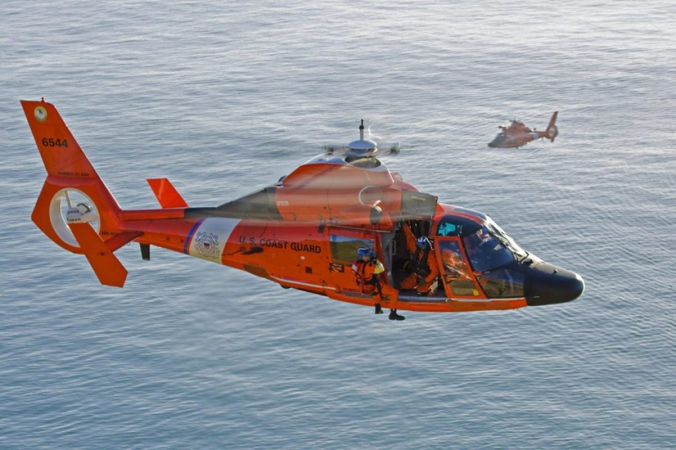 An MH-65 Dolphin helicopter crew from Coast Guard Sector Humboldt Bay conducts hoist training off the coast of Trinidad Head, Jan. 15, 2009.