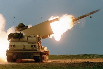 MLRS fires a Guided Multiple Launch Rocket System rocket. (Photo Credit: Courtesy)