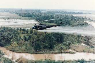 U.S. Huey helicopter spraying Agent Orange over Vietnam (U.S. Department of Defense image)