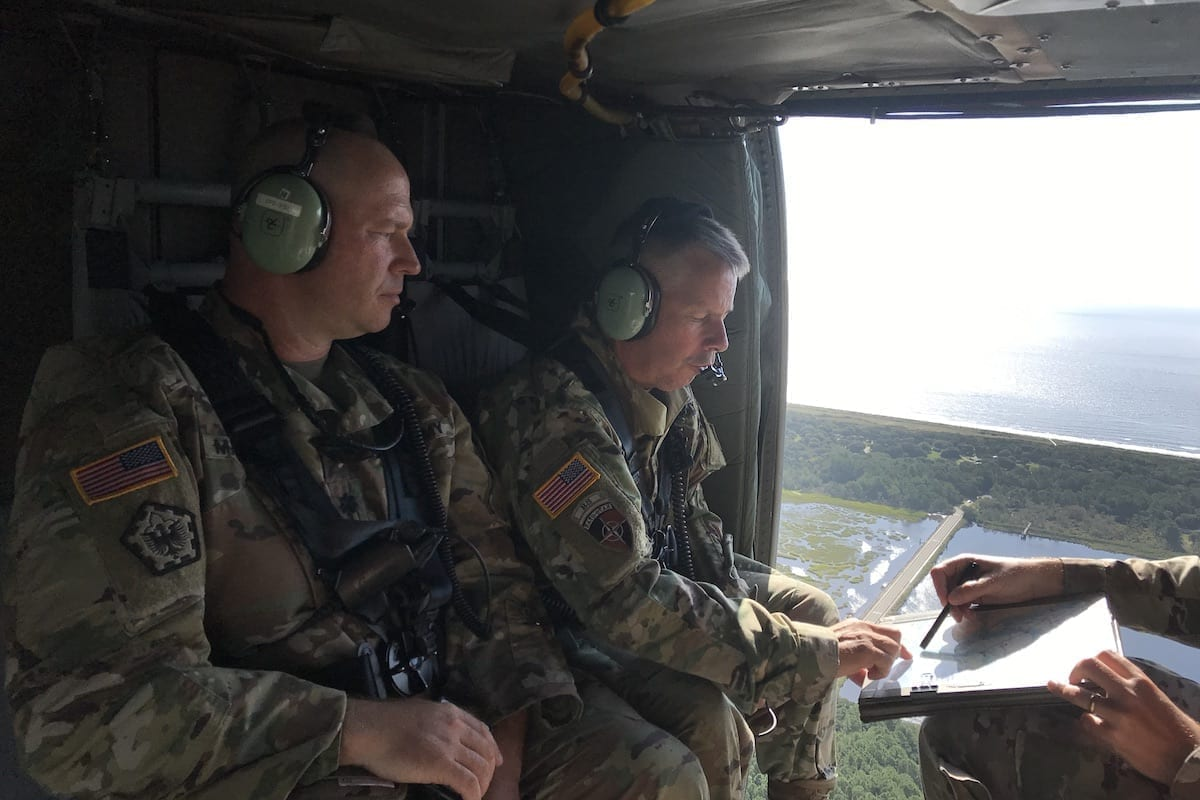 Lt. Gen. Todd Semonite (center) and team on a mission to survey the damage of Hurricane Florence in 2018. Semonite's Revolutionize efforts with emergency response include the use of sophisticated technology to stop or channel rising waters away from populated areas and remotely survey dams and levees that are near capacity. (Photo by Lt. Col. Justin Pritchard)
