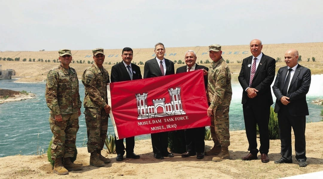 Participants celebrate the completion of the Mosul Dam Task Force (MDTF) mission on the bank of the Tigris River. Pictured left to right are: USACE TAD Command Sgt. Maj. Randolph Delapena; former TAD Commander Col. Mark Quander; Iraq MoWR Director General Mahdi Rashid; U.S. Ambassador to Iraq Matthew H. Tueller; Iraq Water Resources Minister Jamal al-Adili; MDTF Commander Col. Philip Secrist; Mosul Dam Project Manager Riyadh Ali; and Jamal Mohsin, Iraq director general of Planning and Follow-up. The dignitaries visited the MDTF on June 15, 2019, for a ceremony commemorating the completion of the Mosul Dam Project.Photo Courtesy of the Transatlantic Division