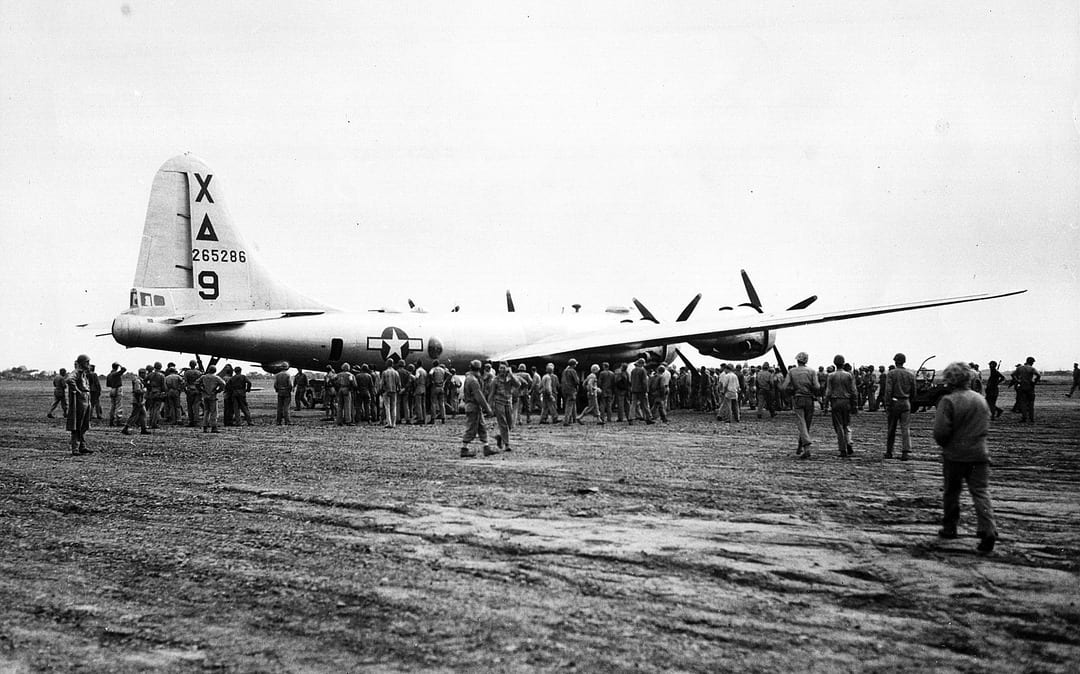 Dinah Might, the first B-29 bomber to make an emergency landing at Motoyama Airfield No. 1 on Iwo Jima is surrounded by Marines and Seabees, March 4, 1945. Having Iwo Jima's airfields to divert to in case of damage or emergencies is said to have saved the lives of up to 24,000 flight crew. U.S. MARINE CORPS PHOTO